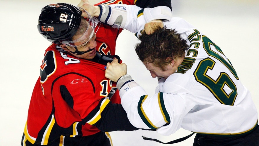 Dallas Stars' Antoine Roussel, right, of France, fights with Calgary Flames' Jarome Iginla during the second period of their NHL hockey game, Wednesday, Feb. 13, 2013, in Calgary, Alberta. (AP Photo/The Canadian Press, Jeff McIntosh)