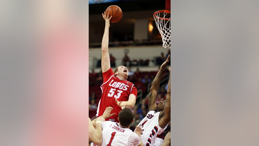 New Mexico's Alex Kirk (53) shoots against Fresno State's Kevin Foster in the second half of an NCAA college basketball game in Fresno, Calif., Wednesday, Feb. 13, 2013. New Mexico won 54-48. (AP Photo/Gary Kazanjian)