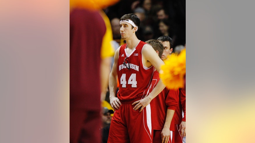 Wisconsin's Frank Kaminsky (44) reacts after losing to Minnesota 58-53 in overtime in an NCAA college basketball game, Thursday, Feb. 14, 2013, in Minneapolis. (AP Photo/Genevieve Ross)
