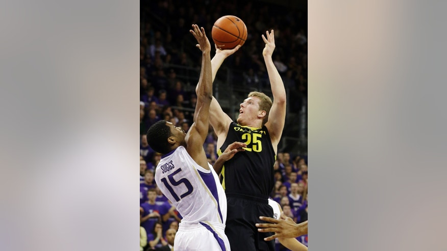 Oregon's E.J. Singler (25) shoots over Washington's Scott Suggs (15) in the first half of an NCAA college basketball game, Wednesday, Feb. 13, 2013, in Seattle. (AP Photo/Ted S. Warren)