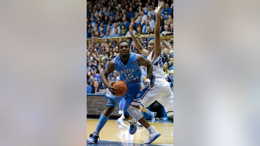 Duke's Rasheed Sulaimon, right, guards North Carolina's P.J. Hairston (15) during the second half of an NCAA college basketball game in Durham, N.C., Wednesday, Feb. 13, 2013.  Duke won 73-68. (AP Photo/Gerry Broome)