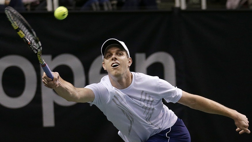 Sam Querrey, of the United States, returns to Lleyton Hewitt, from Australia, during a match at the SAP Open tennis tournament in San Jose, Calif., Thursday, Feb. 14, 2013. Querrey won 7-6 (6), 1-6, 7-6 (4). (AP Photo/Jeff Chiu)