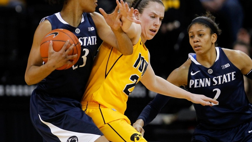 Iowa guard Samantha Logic (22) puts pressure on Penn State forward Ariel Edwards (23) during the first half of an NCAA college basketball game on Thursday, Feb. 14, 2013, at Carver-Hawkeye Arena in Iowa City, Iowa. (AP Photo/The Gazette, Brian Ray)