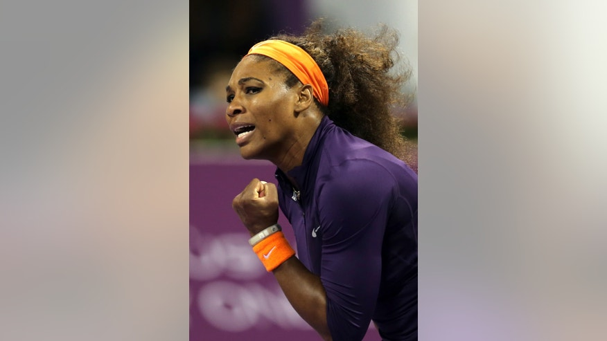 Serena Williams of the U.S. reacts after winning a point during her match against Poland's Urszula Radwanska on the third day of the WTA Qatar Ladies Open tennis tournament in Doha, Qatar, Thursday , Feb. 14, 2013. (AP Photo/Osama Faisal)