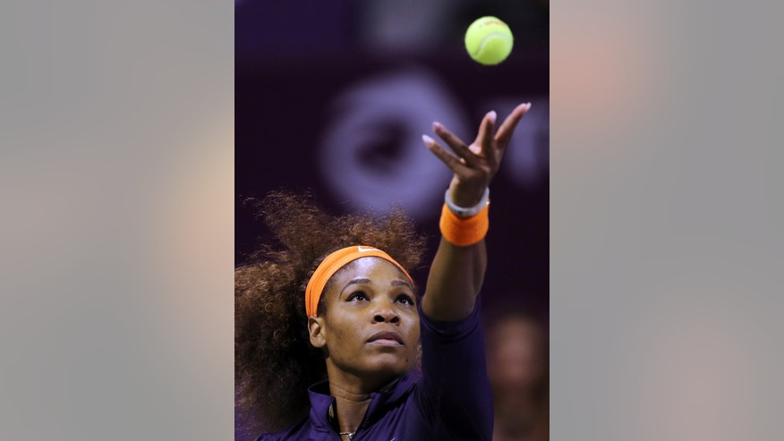 Serena Williams of the U.S. serves to Poland's Urszula Radwanska during the fourth day of the WTA Qatar Ladies Open tennis tournament in Doha, Qatar, Thursday, Feb. 14, 2013. (AP Photo/Osama Faisal)