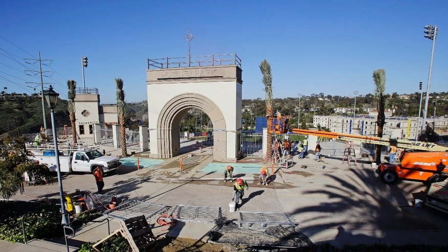 Construction work continues on Fowler Park, a ballpark on the campus of the University of San Diego, Thursday, Feb. 14, 2013, in anticipation of the school's opening three-game NCAA college baseball series against San Diego State on Friday in San Diego. (AP Photo/Lenny Ignelzi)
