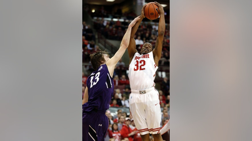 Ohio State's Lenzelle Smith Jr., right, works for a rebound against Northwestern's Kale Abrahamson during the first half of an NCAA college basketball game in Columbus, Ohio, Thursday, Feb. 14, 2013. (AP Photo/Paul Vernon)