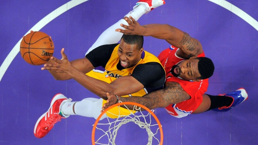 Los Angeles Lakers center Dwight Howard, left, shoots as Los Angeles Clippers center DeAndre Jordan defends during the first half of their NBA basketball game, Thursday, Feb. 14, 2013, in Los Angeles.  (AP Photo/Mark J. Terrill)