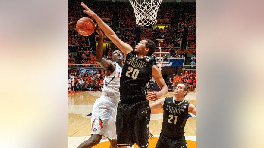 Illinois' Nnanna Egwu (32) tries to shoot against Purdue's A.J. Hammons (20) during the first half of their NCAA college basketball game, Wednesday, Feb. 13, 2013, in Champaign, Ill. (AP Photo/Darrell Hoemann)