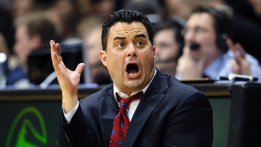 Arizona head coach Sean Miller argues for a call while facing Colorado in the second half of Colorado's 71-58 victory in an NCAA college basketball game in Boulder, Colo., Thursday, Feb. 14, 2013. (AP Photo/David Zalubowski)