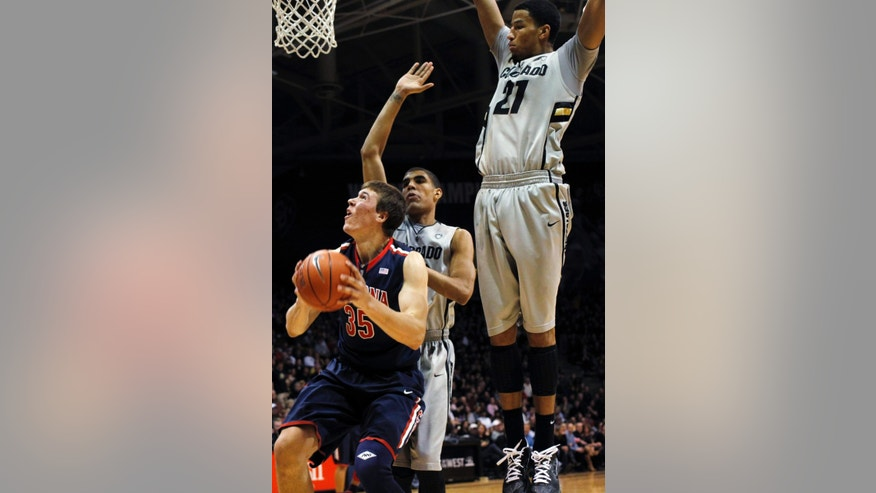Arizona center Kaleb Tarczewski, left, goes up for a shot as Colorado center Josh Scott, center, and forward Andre Roberson defend in the second half of Colorado's 71-58 victory in an NCAA college basketball game in Boulder, Colo., Thursday, Feb. 14, 2013. (AP Photo/David Zalubowski)