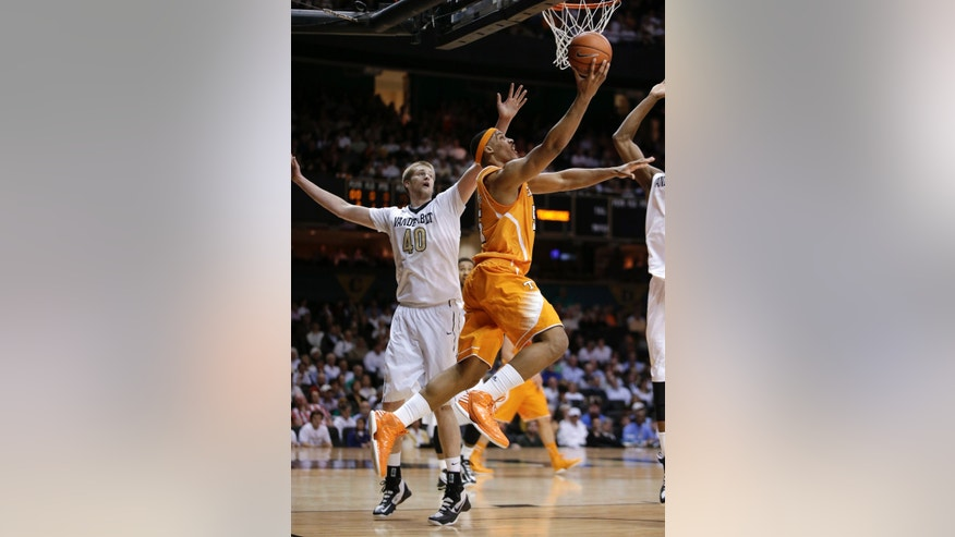 Tennessee forward Jarnell Stokes, right, scores ahead of Vanderbilt center Josh Henderson (40) in the first half of an NCAA college basketball game Wednesday, Feb. 13, 2013, in Nashville, Tenn. (AP Photo/Mark Humphrey)
