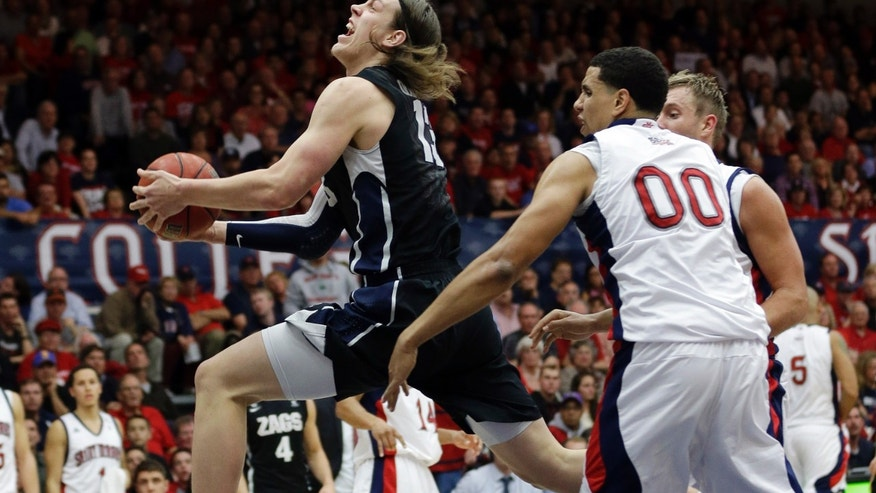 Gonzaga's Kelly Olynyk, left, shoots past St. Mary's Brad Waldow (00) during the first half of an NCAA college basketball game in Moraga, Calif., Thursday, Feb. 14,  2013. (AP Photo/Marcio Jose Sanchez)