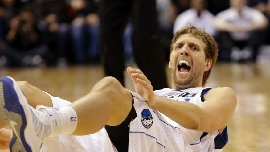 ADVANCE FOR WEEKEND EDITIONS, FEB. 16-17 - FILE - In this Jan. 5, 2012, file photo, Dallas Mavericks power forward Dirk Nowitzki, of Germany, reacts to being knocked to the floor during the second half of an NBA basketball game against the New Orleans Hornets in Dallas. He's in his second straight season with an entirely new roster, and a 12-year playoff streak is in jeopardy because he missed the first 27 games after the first knee surgery of his career.  (AP Photo/LM Otero, File)