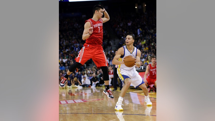 Golden State Warriors' Stephen Curry, right, looks to shoot as Houston Rockets' Jeremy Lin (7) defends during the second half of an NBA basketball game in Oakland, Calif., Tuesday, Feb. 12, 2013. Houston won 116-107. (AP Photo/Marcio Jose Sanchez)