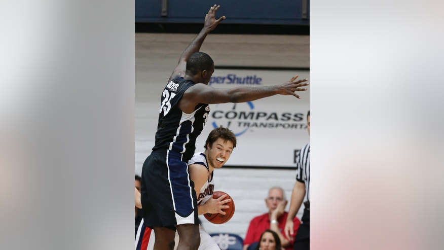 St. Mary's Matthew Dellavedova, right, looks to pass as Gonzaga's Sam Dower (35) defends during the first half of an NCAA college basketball game in Moraga, Calif., Thursday, Feb. 14, 2013. (AP Photo/Marcio Jose Sanchez)