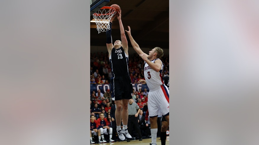Gonzaga's Kelly Olynyk (13) shoots next to St. Mary's Mitchell Young (3) during the first half of an NCAA college basketball game in Moraga, Calif., Thursday, Feb. 14, 2013. (AP Photo/Marcio Jose Sanchez)