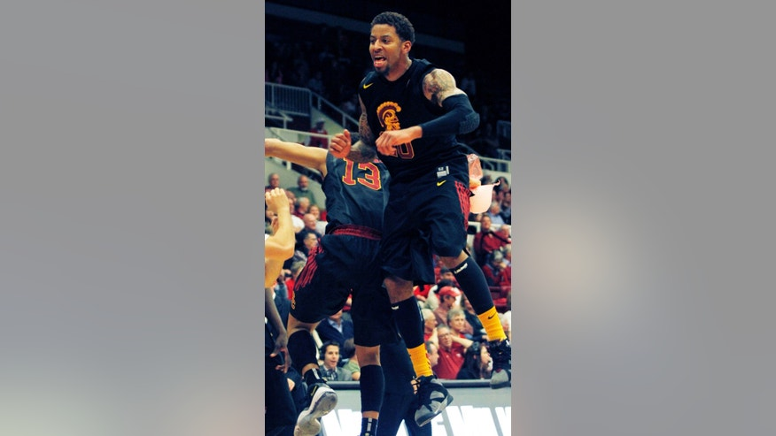 Southern California's J.T. Terrell, right, celebrates with teammate Chass Bryan (13) during the first half of an NCAA college basketball game against Stanford in Stanford, Calif., Thursday, Feb. 14, 2013. (AP Photo/George Nikitin)