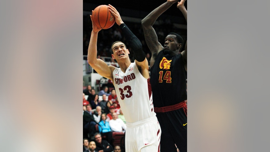 Stanford's Dwight Powell (33) shoots as Southern California's Dewayne Dedmon defends during the first half of an NCAA college basketball game in Stanford, Calif., Thursday, Feb. 14, 2013. (AP Photo/George Nikitin)
