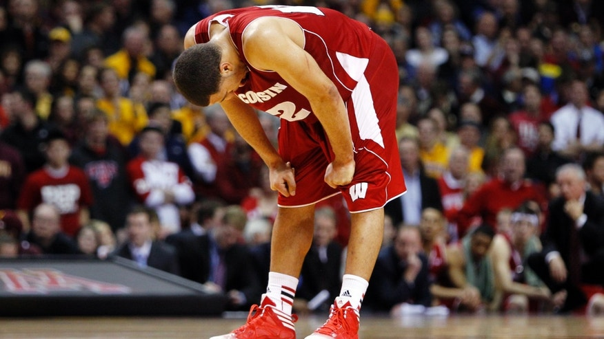 Wisconsin's Traevon Jackson (12) reacts as Minnesota hits a free throw during overtime in an NCAA college basketball game, Thursday, Feb. 14, 2013, in Minneapolis. Minnesota won 58-53. (AP Photo/Genevieve Ross)
