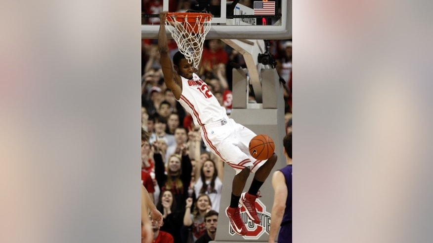 Ohio State's Sam Thompson dunks against Northwestern during the first half of an NCAA college basketball game in Columbus, Ohio, Thursday, Feb. 14, 2013. (AP Photo/Paul Vernon)
