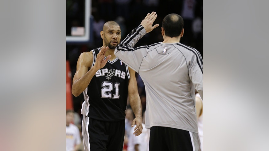 San Antonio Spurs' Tim Duncan, left, is congratulated by Manu Ginobili after the Spurs defeated the Cavaliers 96-95 in an NBA basketball game Wednesday, Feb. 13, 2013, in Cleveland. (AP Photo/Tony Dejak)