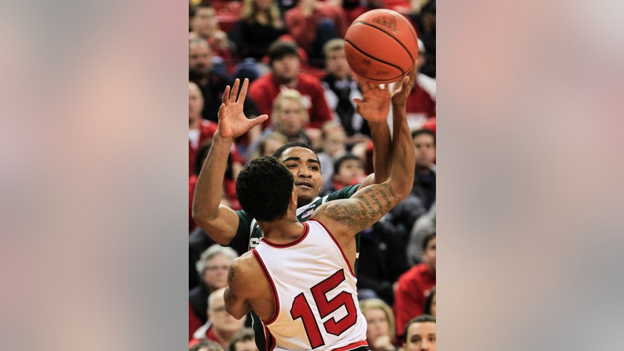 Michigan State's Gary Harris, rear, and Nebraska's Ray Gallegos (15) compete for the ball in the first half of an NCAA college basketball game in Lincoln, Neb., Saturday, Feb. 16, 2013. (AP Photo/Nati Harnik)