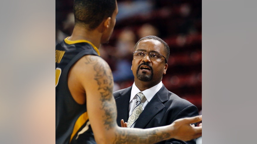 Missouri coach Frank Haith talks to guard Jabari Brown during the  second half of an NCAA college basketball game against Mississippi State in Starkville, Miss., Wednesday, Feb. 13, 2013. Missouri won 78-36. (AP Photo/Rogelio V. Solis)