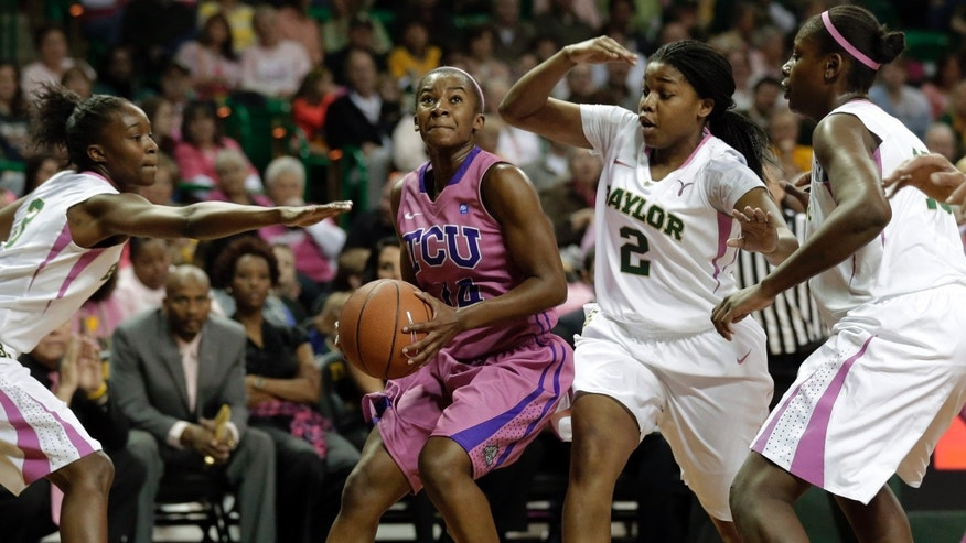 Baylor 's Jordan Madden, left, Niya Johnson (2), second from right,  and Destiny Williams, right, defend against a drive to the basket by TCU 's Zahna Medley (14) in the first half of an NCAA college basketball game Saturday, Feb. 16, 2013, in Waco, Texas. (AP Photo/Tony Gutierrez)
