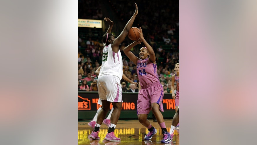 Baylor 's Sune Agbuke (22) forces a turnover against TCU 's Ashley Colbert (44) as she loses control of the ball in the first half of an NCAA college basketball game Saturday, Feb. 16, 2013, in Waco, Texas. (AP Photo/Tony Gutierrez)