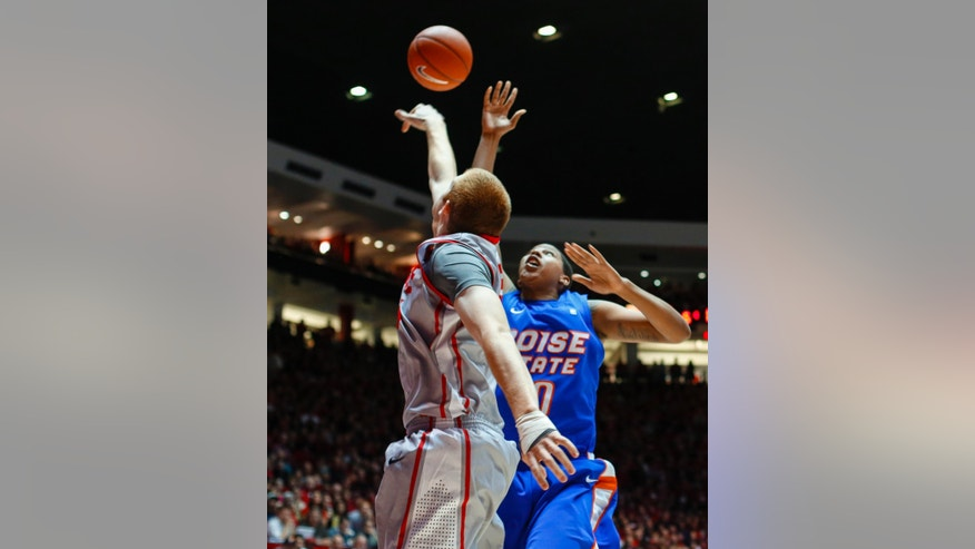 New Mexico's Alex Kirk, left, blocks a shot by Boise State's Ryan Watkins during the first half of an NCAA college basketball game Saturday, Feb. 16, 2013, at the Pit in Albuquerque, N.M. (AP Photo/Jake Schoellkopf)