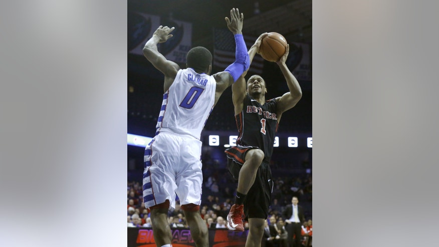 Rutgers guard Jerome Seagears (1) drives to the bucket as DePaul guard Worrel Clahar defends during the first half of an NCAA college basketball game Saturday, Feb. 16, 2013, in Rosemont, Ill. (AP Photo/Charles Rex Arbogast)
