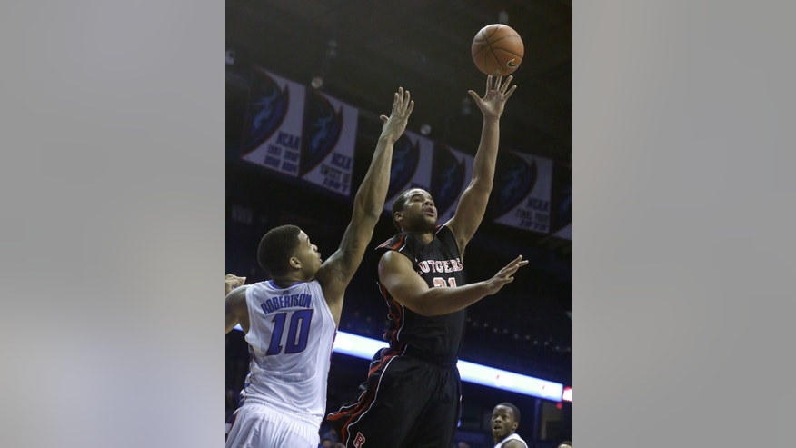 Rutgers forward Austin Johnson (21) shoots over DePaul center Derrell Robertson Jr. during the first half of an NCAA college basketball game Saturday, Feb. 16, 2013, in Rosemont, Ill. (AP Photo/Charles Rex Arbogast)