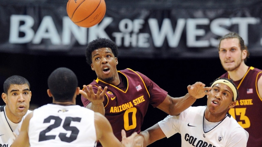Arizona State's Carrick Felix (0) tries to control a tipped ball in front of Colorado's Xavier Johnson (2) during the first half of an NCAA college basketball game on Saturday, Feb. 16, 2013, in Boulder, Colo. (AP Photo/Daily Camera, Cliff Grassmick)  NO SALES; MAGAZINES OUT