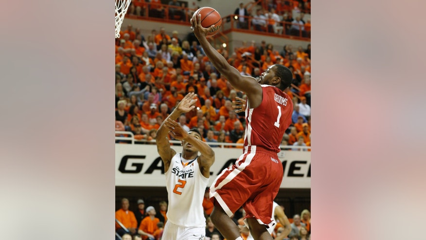 Oklahoma guard Sam Grooms (1) shoots in front of Oklahoma State guard Le'Bryan Nash (2) in the second half of an NCAA college basketball game in Stillwater, Okla., Saturday, Feb. 16, 2013. Oklahoma State won 84-79. (AP Photo/Sue Ogrocki)