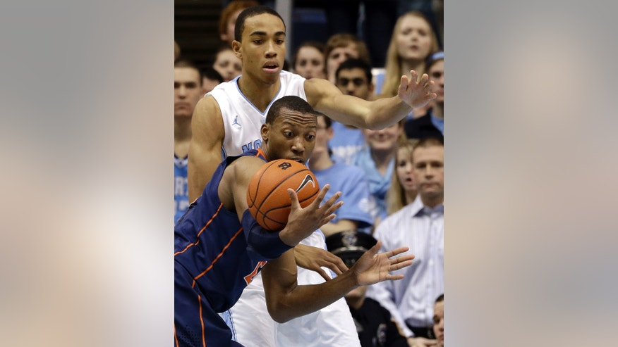 North Carolina's Brice Johnson, rear, guards Virginia's Akil Mitchell during the first half of an NCAA college basketball game in Chapel Hill, N.C., Saturday, Feb. 16, 2013. (AP Photo/Gerry Broome)