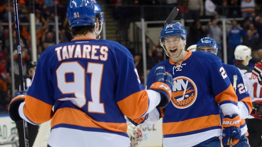 New York Islanders' John Tavares, left, celebrates with teammate Brad Boyes after scoring their team's second goal against the New Jersey Devils in the second period of an NHL hockey game in Uniondale, N.Y., Saturday, Feb. 16, 2013. (AP Photo/Henny Ray Abrams)