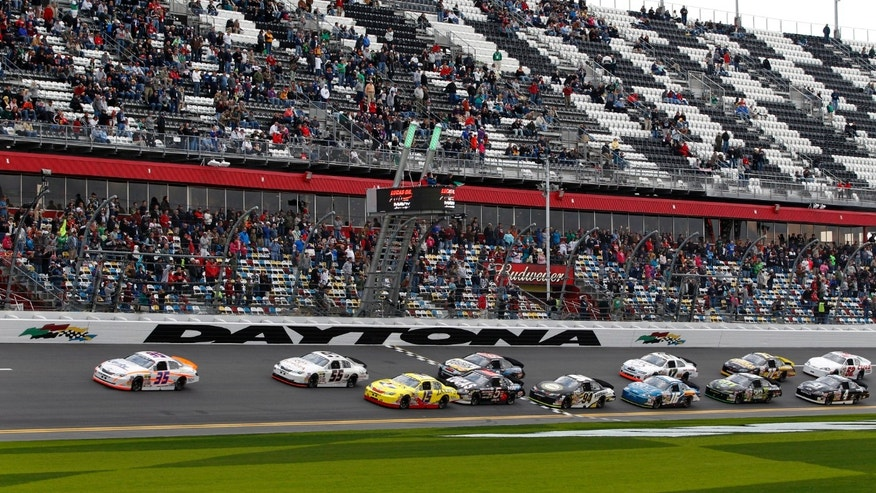 Milka Duno (35), of Venezuela, passes pole-sitter John Wes Townley (15) and moves to the front of the pack after the start of the ARCA Series auto race at Daytona International Speedway, Saturday, Feb. 16, 2013, in Daytona Beach, Fla. (AP Photo/Terry Renna)