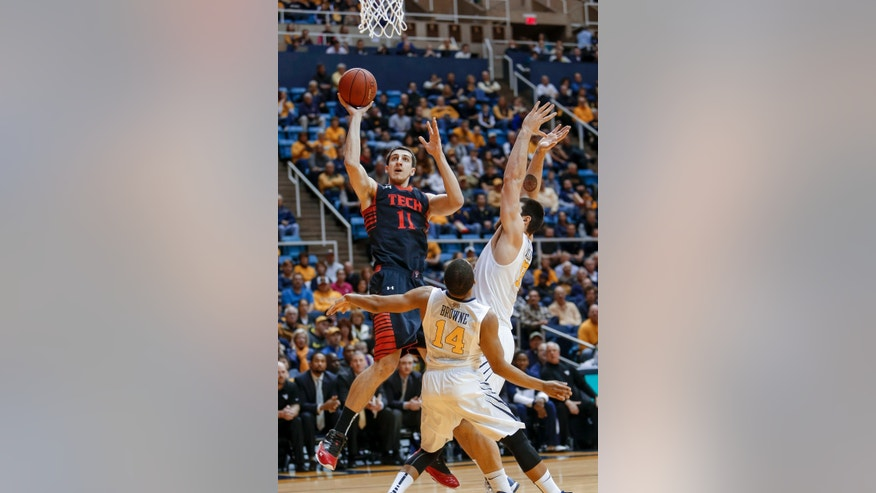 Texas Tech's Dejan Kravic (11) shoots over West Virginia's Deniz Kilicli, right, and Gary Browne (14) during the first half of an NCAA college basketball game at WVU Coliseum in Morgantown, W.Va., on Saturday, Feb. 16, 2013. (AP Photo/David Smith)