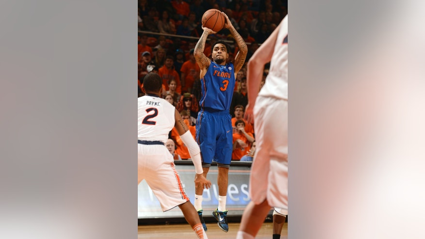 Florida's Mike Rosario shoots a three pointer in the first half of an NCAA college basketball game against Auburn on Saturday, Feb. 16, 2013 in Auburn, Ala.(AP Photo/Todd J. Van Emst)