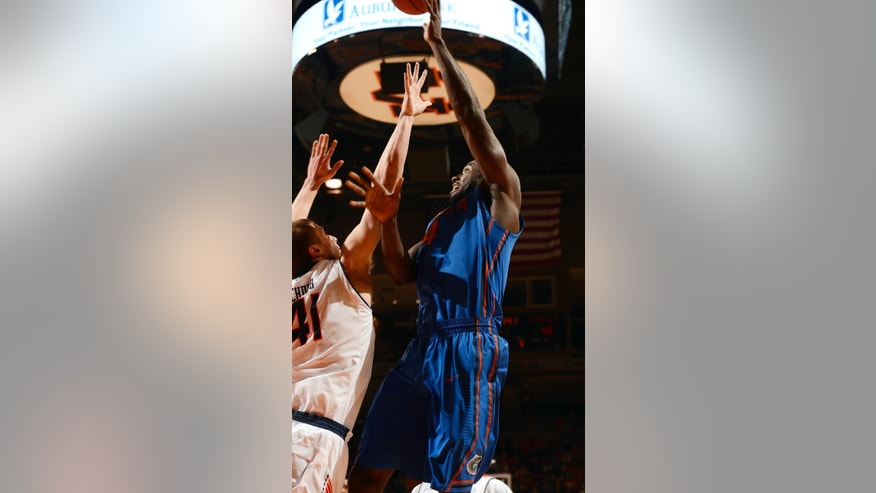 Florida's Patric Young shoots over Auburn's Rob Chubb in the first half of their NCAA college basketball game on Saturday, Feb. 16, 2013 in Auburn, Ala.(AP Photo/Todd J. Van Emst)