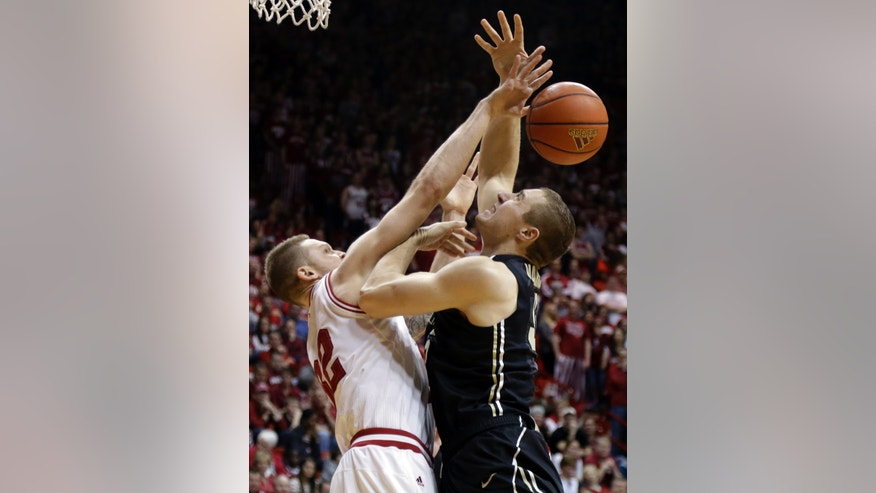 Purdue forward Sandi Marcius, right, is fouled by Indiana forward Derek Elston in the first half of a NCAA college basketball game in Bloomington, Ind., Saturday, Feb. 16, 2013. (AP Photo/Michael Conroy)