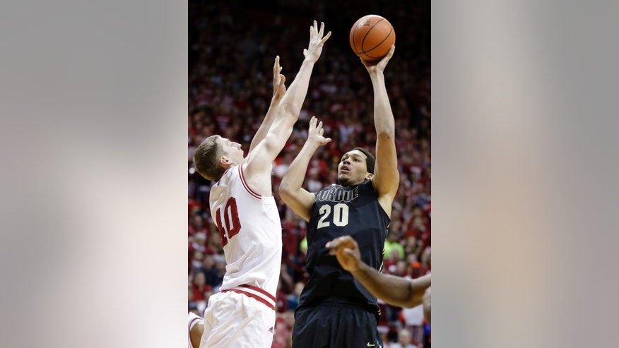 Purdue center A.J. Hammons, right, shoots over Cody Zeller in the first half of a NCAA college basketball game in Bloomington, Ind., Saturday, Feb. 16, 2013. (AP Photo/Michael Conroy)