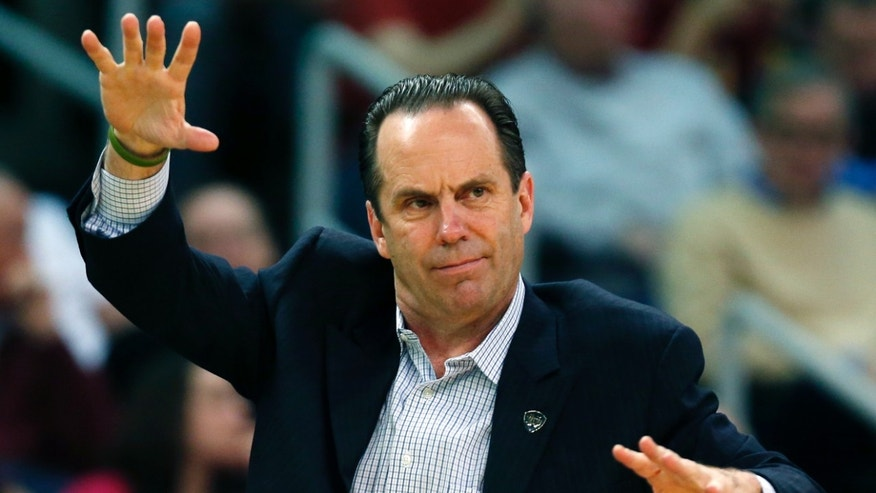 Notre Dame head coach Mike Brey signals his team in the second half of an NCAA college basketball game against Providence in Providence, R.I., Saturday, Feb. 16, 2013. Providence won 71-54. (AP Photo/Michael Dwyer)