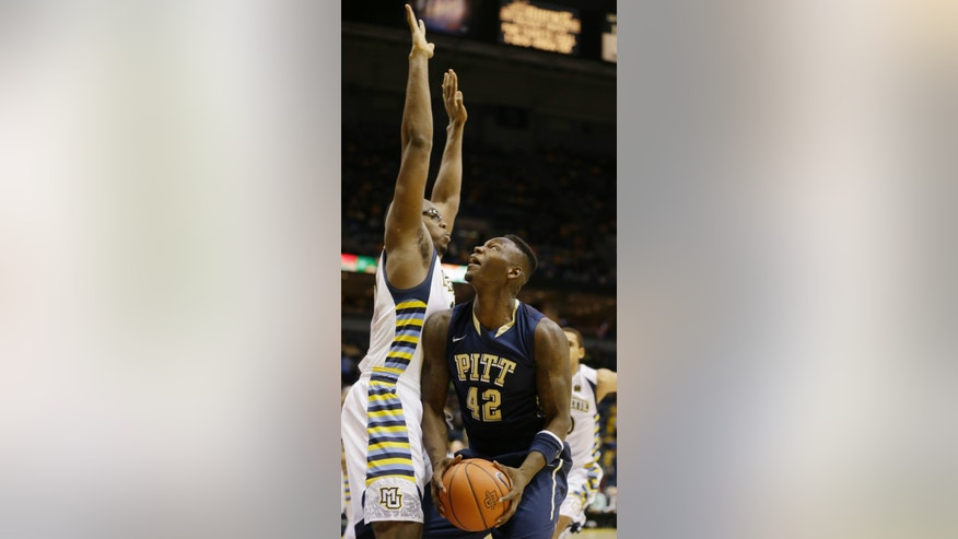 Marquette's Chris Otule, left, defends Pittsburgh's Talib Zanna (42) during the second half of an NCAA college basketball game Saturday, Feb. 16, 2013, in Milwaukee. (AP Photo/Jeffrey Phelps)