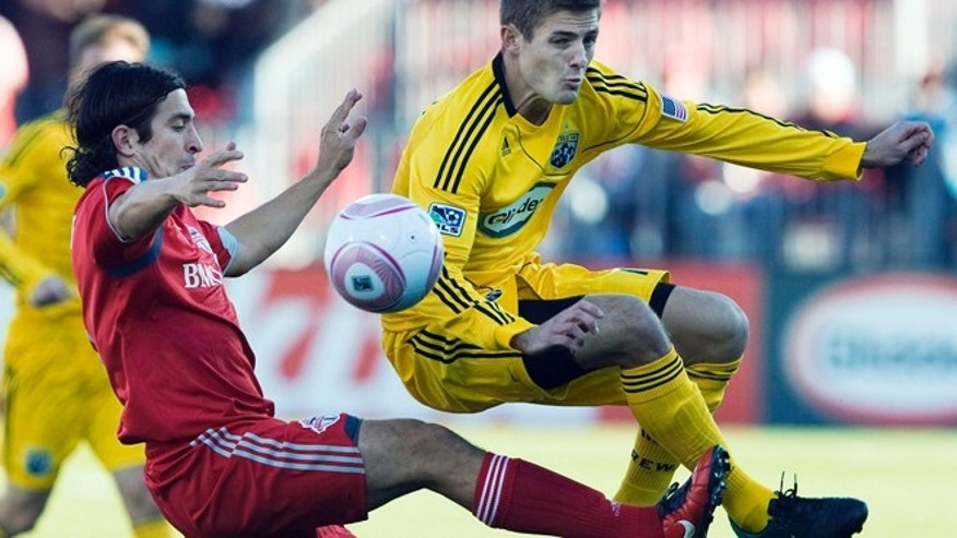 Oct. 16, 2010: In this file photo, Toronto FC defender Nick Garcia, left, battles for the ball against Columbus Crew midfielder Robbie Rogers, right, during first half MLS soccer action in Toronto.