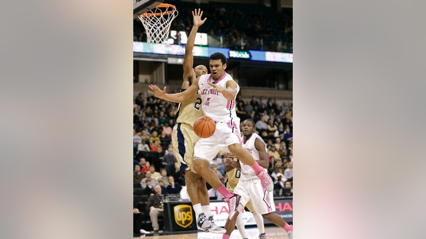 Wake Forest's Devin Thomas, right, is fouled by Georgia Tech's Kammeon Holsey, left, during the first half of an NCAA college basketball game in Winston-Salem, N.C., Saturday, Feb. 16, 2013. (AP Photo/Chuck Burton)