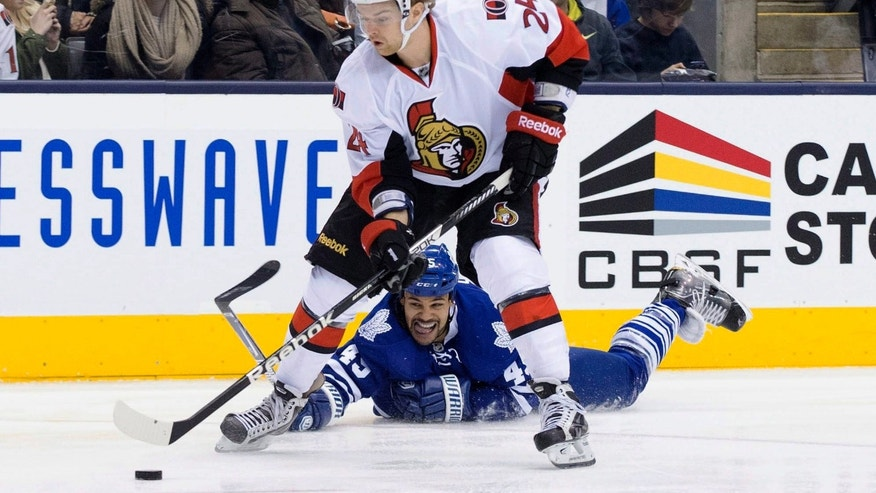 Toronto Maple Leafs' Mark Fraser tries to reach for a puck as Ottawa Senators' Stephane Da Costa skates toward the net during the first period of an NHL hockey game in Toronto on Saturday, Feb. 16, 2013. (AP Photo/The Canadian Press, Chris Young)