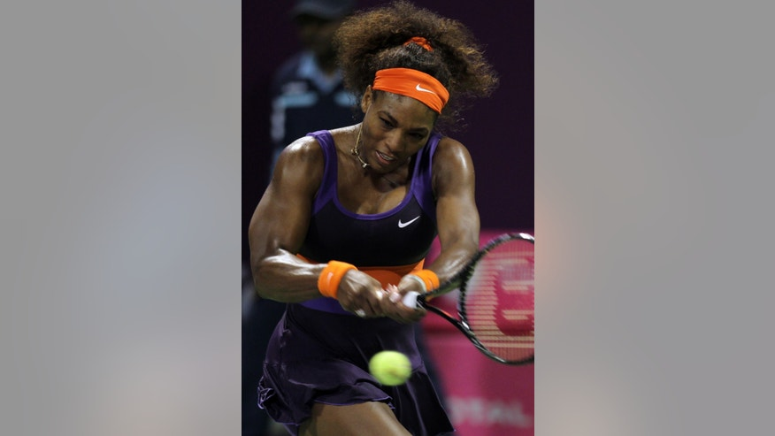 Serena Williams of the U.S. returns the ball to Petra Kvitova of Czech Republic during their quarterfinal of the WTA Qatar Ladies Open tennis tournament in Doha, Qatar, Friday, Feb. 15, 2013. (AP Photo/Osama Faisal)
