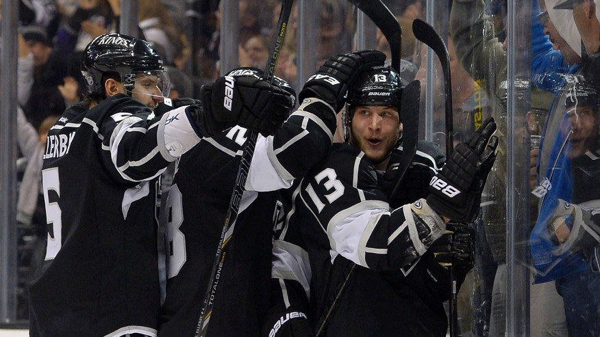 Los Angeles Kings left wing Kyle Clifford, right, celebrates his goal with teammates, defenseman Keaton Ellerby, left, and center Jarret Stoll, during the second period of their NHL hockey game against the Columbus Blue Jackets, Friday, Feb. 15, 2013, in Los Angeles.  (AP Photo/Mark J. Terrill)